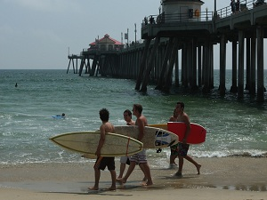 Surfers at Huntington Beach Pier